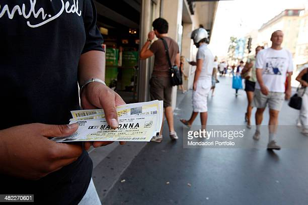 A fan keeps in his hands the tickets of Madonna's concert in Nice that will take place at Palais Nikaia the singer is performing her Sticky and Sweet...