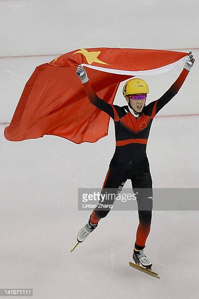 Fan Kexin of China holds a Chinese flag and celebraes after winning the Women's 500m final during day two of the ISU World Short Track Speed Skating...