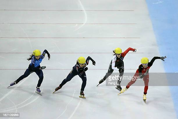 Fan Kexin of China Marianne StGelais of Canada Park SeungHi of Korea and Sofia Prosvirnova of Russia compete in the Women's 500m Final during day...