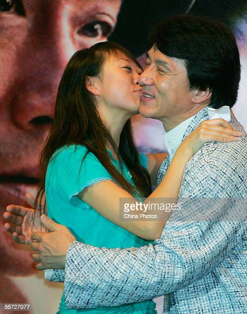 A fan kisses Hong Kong action star Jackie Chan during a press conference to promote Chan's new movie 'The Myth' on September 19 2005 in Chengdu of...