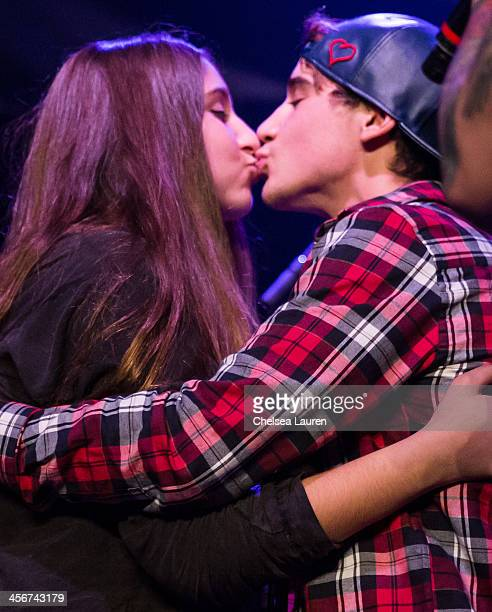 A fan kisses Youtube personality Luke Brooks of The Janoskians on stage at DigiFest LA at Hollywood Palladium on December 14 2013 in Hollywood...