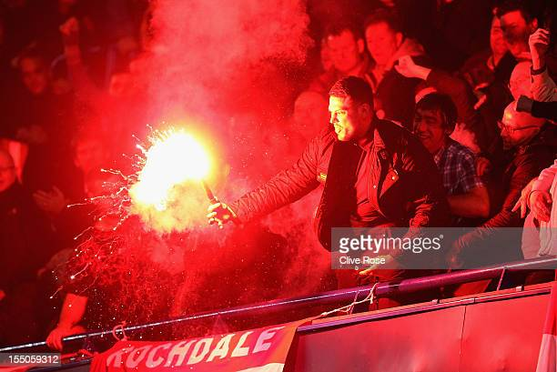 A fan lets off a flare during the Capital One Cup Fourth Round match between Chelsea and Manchester United at Stamford Bridge on October 31 2012 in...