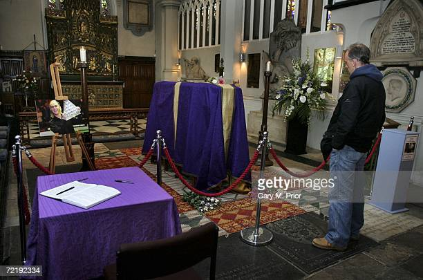 A fan looks at the snooker player Paul Hunter's coffin at Leeds Parish Church on October 17 2006 in Leeds England The threetime Masters champion lost...