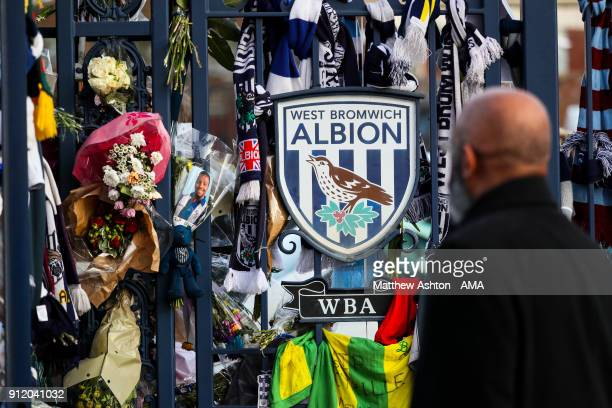 A fan looks at the tributes to Cyrille Regis during the Cyrille Regis Memorial Service at The Hawthorns on January 30 2018 in West Bromwich England