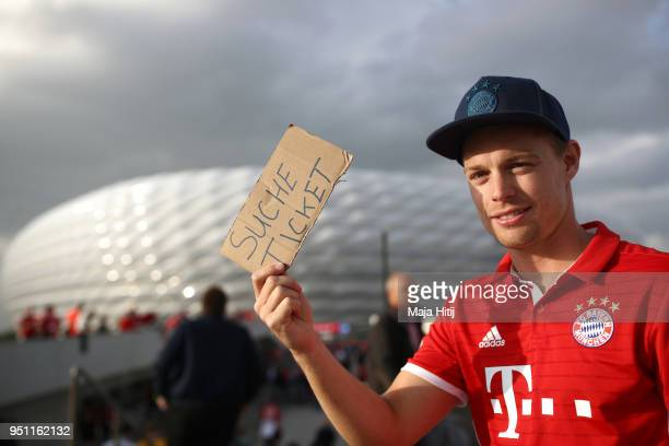 A fan looks for a spare ticket prior to the UEFA Champions League Semi Final First Leg match between Bayern Muenchen and Real Madrid at the Allianz...