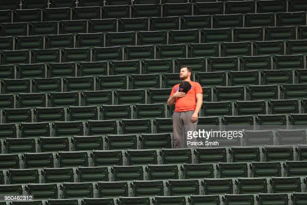 A fan looks on during the national anthem before the Cleveland Indians play against the Baltimore Orioles at Oriole Park at Camden Yards on April 23...