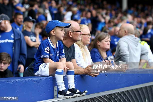 A fan looks on during the Premier League match between Everton FC and Huddersfield Town at Goodison Park on September 1 2018 in Liverpool United...
