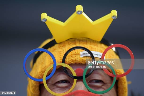 Fan looks on in the women's luge singles run 2 during the Pyeongchang 2018 Winter Olympic Games, at the Olympic Sliding Centre on February 12, 2018...