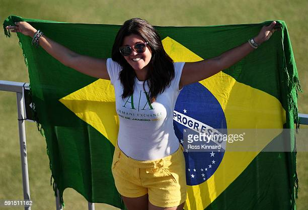 A fan looks on over the 18th hole during the First Round of Women's Golf at Olympic Golf Course on Day 12 of the Rio 2016 Olympic Games on August 17...