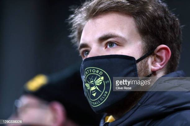 Fan looks on wearing a Brentford FC face mask prior to the Sky Bet Championship match between Brentford and Derby County at Brentford Community...