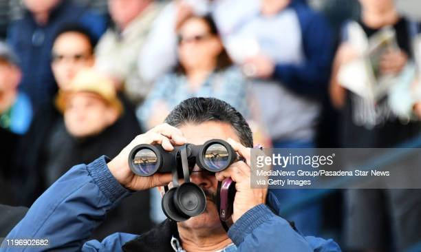 Fan looks on with his binoculars during opening day horse racing at Santa Anita Park on Saturday December 28 2019 in Arcadia California