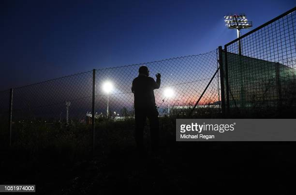 A fan looks through a fence into the stadium prior to the UEFA Nations League A Group Four match between Croatia and England at Stadion HNK Rijeka on...