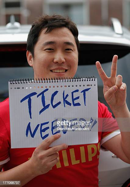 PSV fan looks to buy a ticket prior to the UEFA Champions League Playoff First Leg match between PSV Eindhoven and AC Milan at PSV Stadion on August...