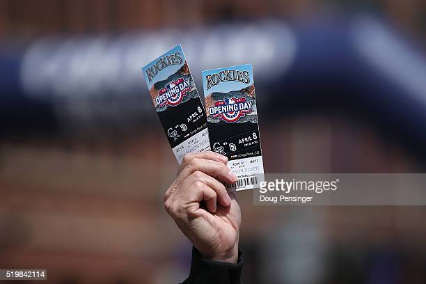 Fan looks to sell tickets outside the stadium as the San Diego Padres face the Colorado Rockies during opening day at Coors Field on April 8, 2016 in...