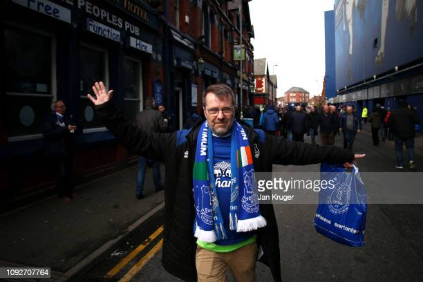 A fan make his way to the stadium prior to the Premier League match between Everton FC and Wolverhampton Wanderers at Goodison Park on February 2...