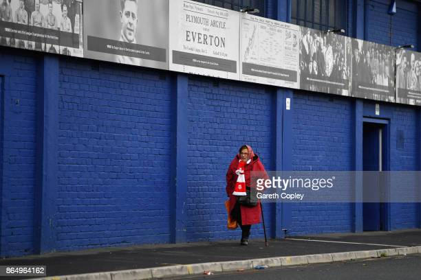 A fan makes her way to the stadium prior to the Premier League match between Everton and Arsenal at Goodison Park on October 22 2017 in Liverpool...