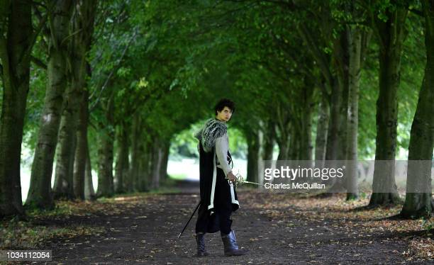 A fan makes his way through a line of trees on the White Walker Trail as the Game of Thrones Winterfell Festival takes place at Castle Ward on...