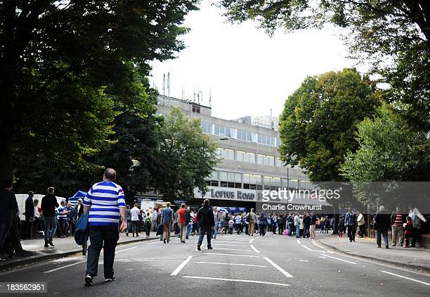Fan makes his way to the ground during the Sky Bet Championship match between Queens Park Rangers and Barnsley at Loftus Road on October 05, 2013 in...