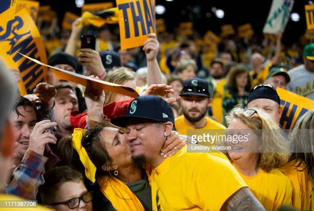 Fan Marianne Mingione kisses Felix Hernandez of the Seattle Mariners as he greets fans after his last game with the Mariners at TMobile Park on...