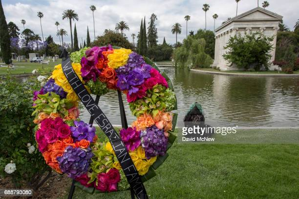 A fan mourns graveside after funeral services for Soundgarden frontman Chris Cornell at Hollywood Forever Cemetery on May 26 2017 in Hollywood...