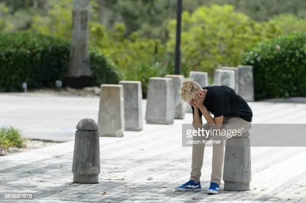 A fan mourns outisde the XXXTentacion Funeral Fan Memorial at BBT Center on June 27 2018 in Sunrise Florida