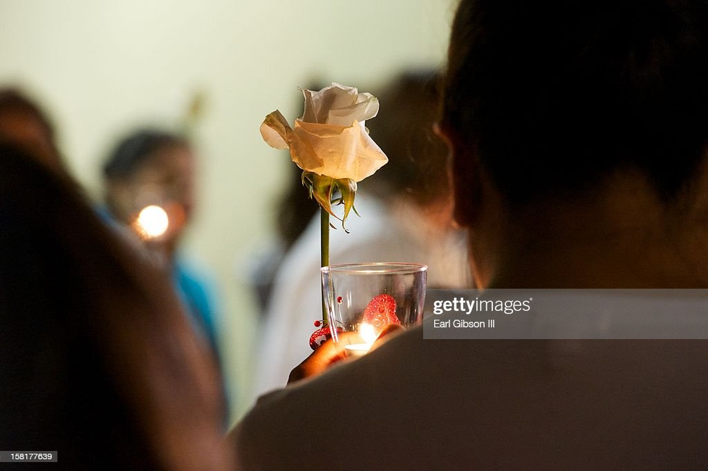 A fan mourns the death of Jenni Rivera at a candlelight vigil on December 10, 2012 in Long Beach, California.