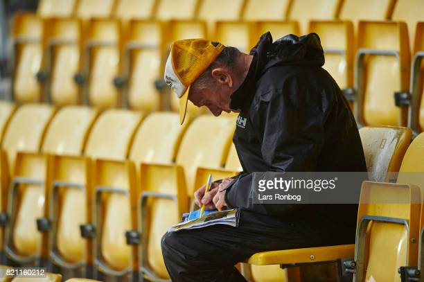 A fan of AC Horsens with the match programme during the Danish Alka Superliga match between AC Horsens and Lyngby BK at CASA Arena on July 23 2017 in...