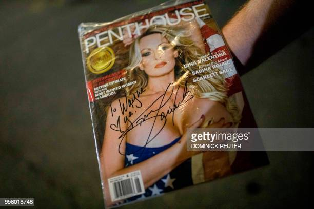 Fan of adult film star Stephanie Clifford, AKA Stormy Daniels, shows off an autographed magazine outside the Penthouse Club in Philadelphia,...