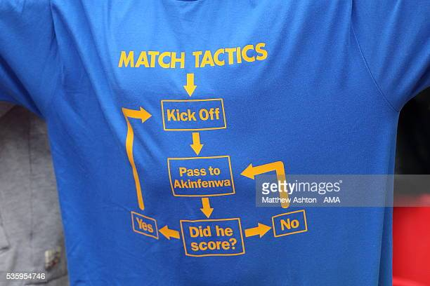 A fan of AFC Wimbledon wears a Tshirt celebrating the tactics of Adebayo Akinfenwa during the Sky Bet League Two Play Off Final between Plymouth...