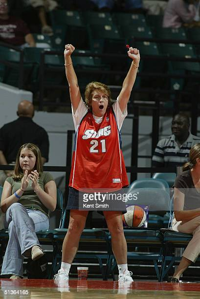 A fan of Allison Feaster of the Charlotte Sting cheers during the game against the Detroit Shock at the Charlotte Coliseum on September 4 2004 in...