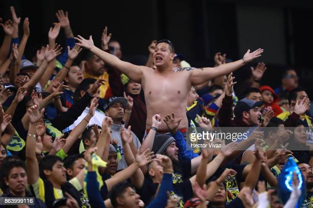 A fan of America cheers during the 10th round match between America and Chivas as part of the Torneo Apertura 2017 Liga MX at Azteca Stadium on...