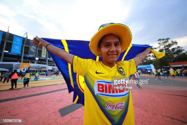 A fan of America poses during the 7th round match between America and Pumas UNAM as part of the Torneo Apertura 2018 Liga MX at Azteca Stadium on...