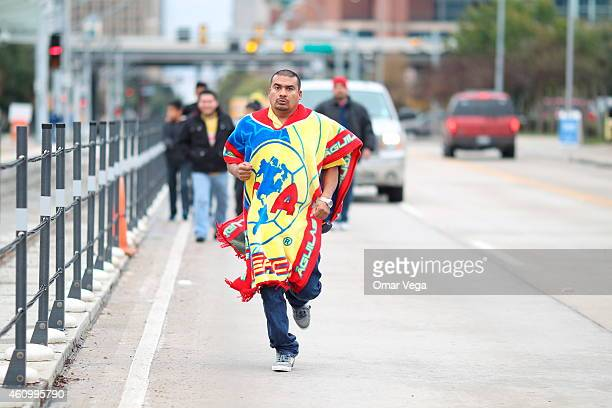 A fan of America runs towards the stadium before a friendly match between America and Monterrey at BBVA Compass Stadium on January 03 2015 in Houston...