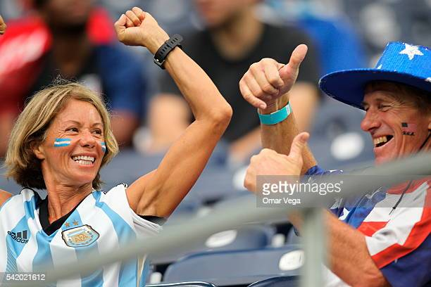 Fan of Argentina and a fan of United States gesture before a Semifinal match between Argentina and US at NRG Stadium as part of Copa America...