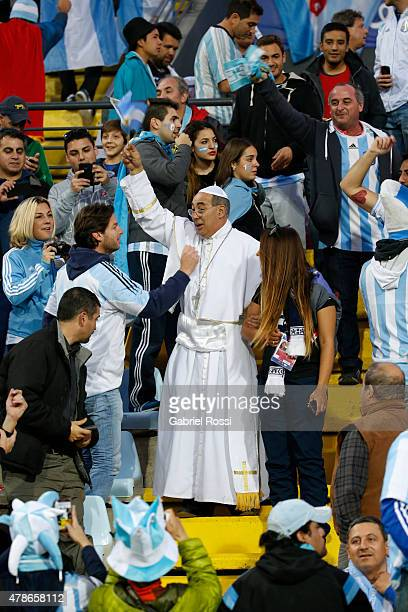 Fan of Argentina disguised as a pope enjoys the atmosphere prior during the 2015 Copa America Chile quarter final match between Argentina and...