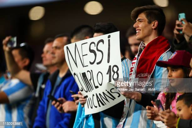 A fan of Argentina holds up a banner for Lionel Messi of Argentina during the International Friendly match between Argentina and Venezuela at Estadio...