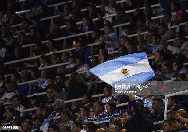 A fan of Argentina waves a flag during an international friendly match between Argentina and Haiti at Alberto J Armando Stadium on May 29 2018 in...