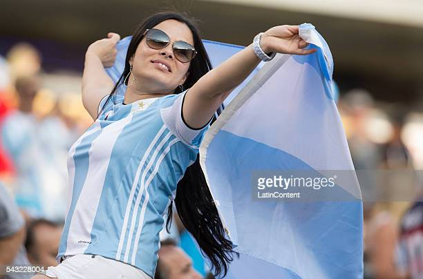 A fan of Argentina waves a flag prior the championship match between Argentina and Chile at MetLife Stadium as part of Copa America Centenario US...