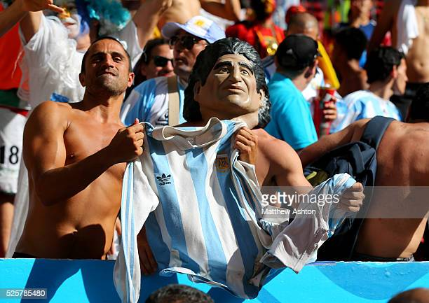 A fan of Argentina wearing a Diego Maradona mask after Argentina reach the FIFA world cup semi final