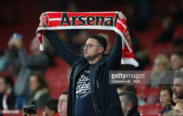 A fan of Arsenal holds up a scarf before the Carabao Cup Fourth Round match between Arsenal and Norwich City at Emirates Stadium on October 24 2017...