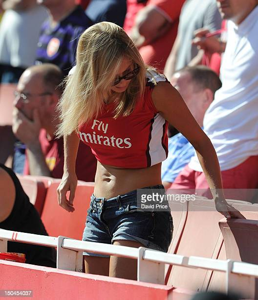 A fan of Arsenal suns herself during the Barclays Premier League match between Arsenal and Sunderland at Emirates Stadium on August 18 2012 in London...