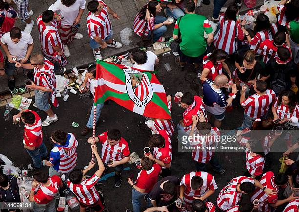 Fan of Athletic Bilbao holds a flag on May 9, 2012 in Bilbao, Spain. Athletic Bibao fans gather around San Mames stadium to watch the Europa League...
