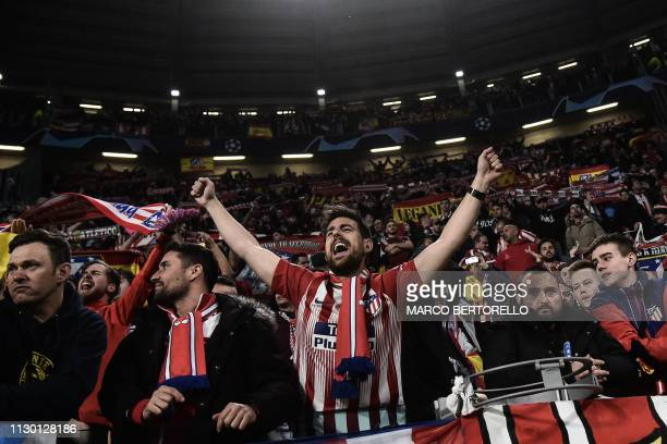 A fan of Atletico cheers during the UEFA Champions League round of 16 secondleg football match Juventus vs Atletico Madrid on March 12 2019 at the...