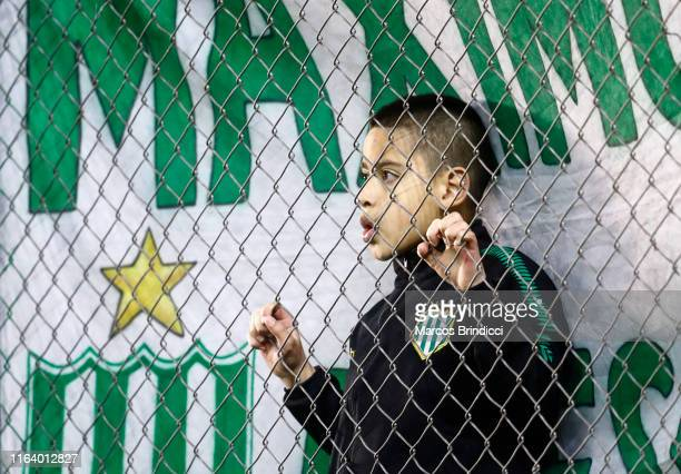 A fan of Banfield watches during a match between Banfield and Boca Juniors as part of Superliga 2019/20 at Florencio Sola Stadium on August 25 2019...