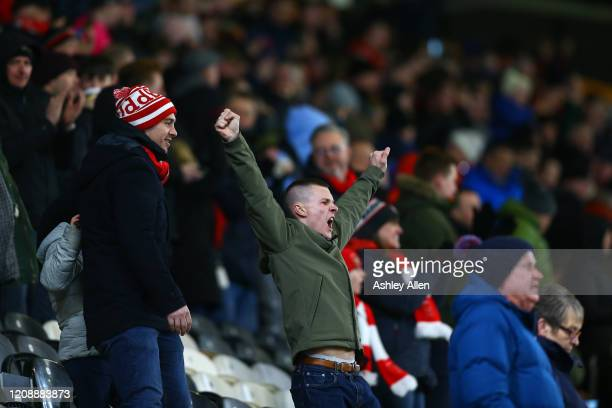 A fan of Barnsley FC cheers during the Sky Bet Championship match between Hull City and Barnsley at KCOM Stadium on February 26 2020 in Hull England