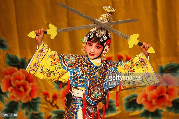 A fan of Beijing opera performs in a traditional theatre on April 11 2009 in Beijing China