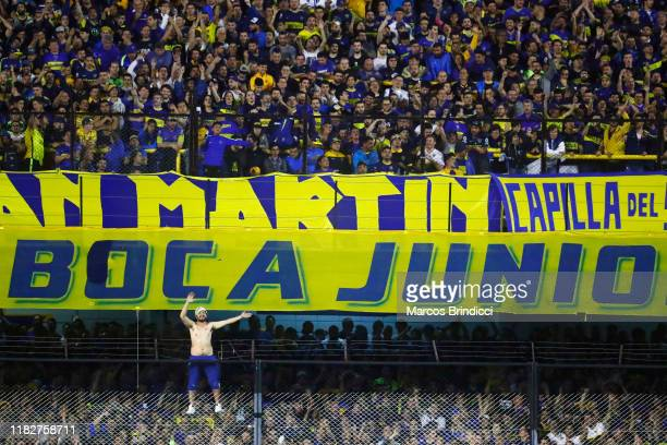 A fan of Boca Juniors cheers their team prior to the Semifinal second leg match between Boca Juniors and River Plate as part of Copa CONMEBOL...