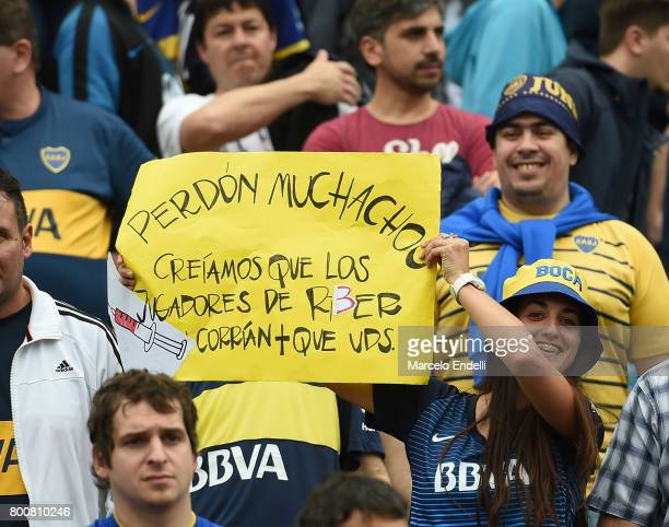 A fan of Boca Juniors holds a sign prior a match between Boca Juniors and Union as part of Torneo Primera Division 2016/17 at Alberto J Armando...