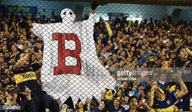 A fan of Boca Juniors is seen dressed as a ghost with a letter B in allusion to the relegation of Argentina's River Plate during a second leg match...
