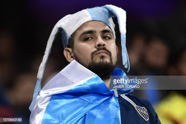 A fan of Boca Juniors waits on the stands before the start of the second leg match of the allArgentine Copa Libertadores final between River Plate...